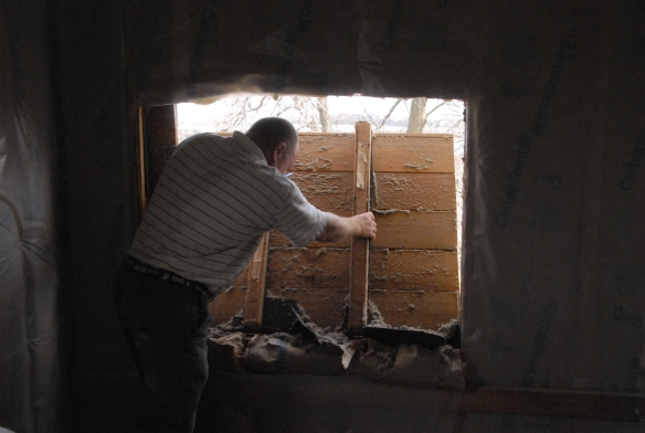 Removing the cut out for the bathroom window.
