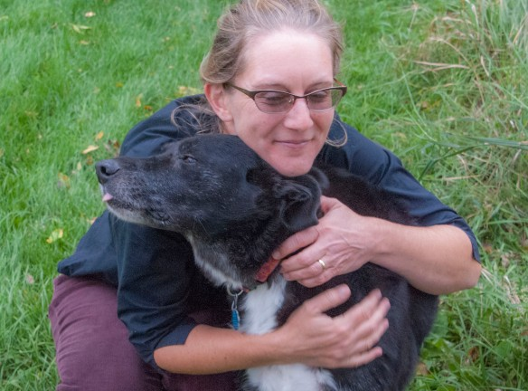 Vega gets a hug as a much-loved dog.